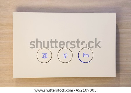 Modern light switch with selected areas in the bedroom - stock photo