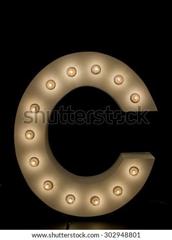 "modern lighting ""C"" alphabet isolated on black background - stock photo"