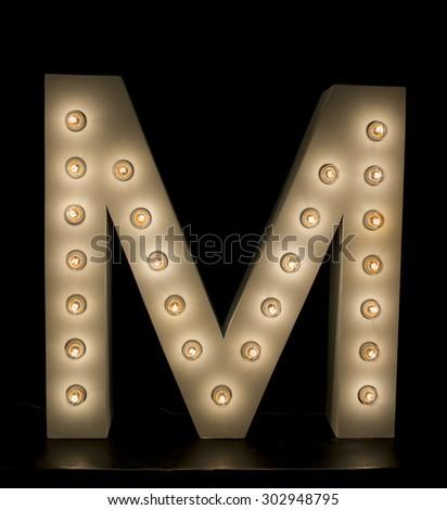"modern lighting ""M"" alphabet isolated on black background - stock photo"