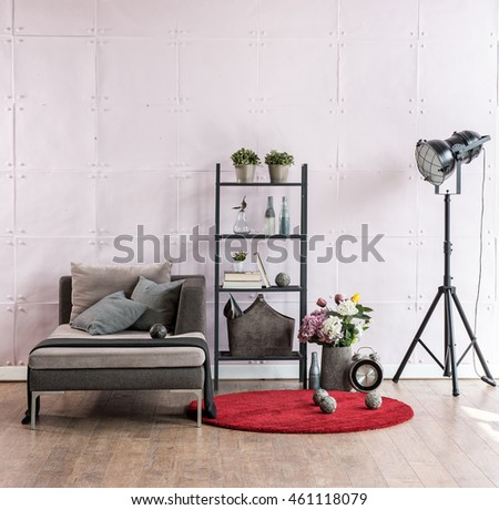 modern living room corner sofa behind stone soft wall and black lamp with red carpet