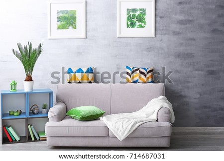 Modern Living Room Design With Framed Pictures Of Tropical Leaves And Sago  Palm Part 76