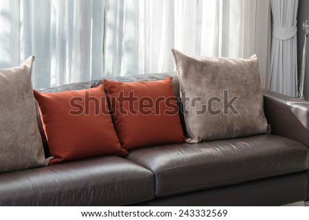 modern living room design with sofa and red pillows - stock photo