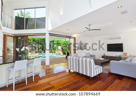 Modern living room in luxury home - stock photo