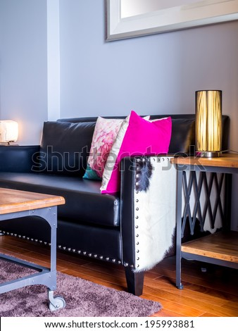 Modern living room interior decorated with vintage black leather couch - stock photo