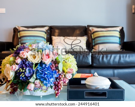 Modern Living room interior design with artificial flower vase - stock photo