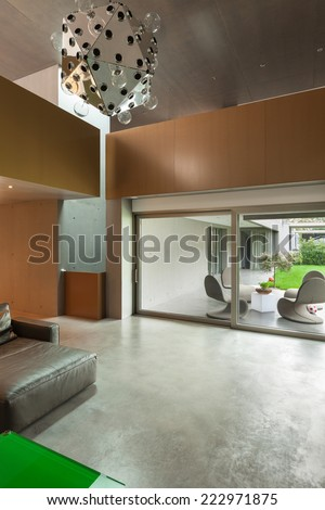 Modern living room, interior house, veranda view - stock photo