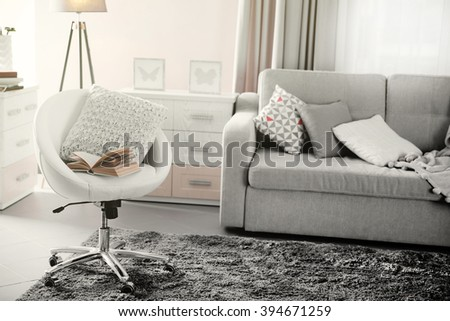 Modern living room interior in grey tones - stock photo