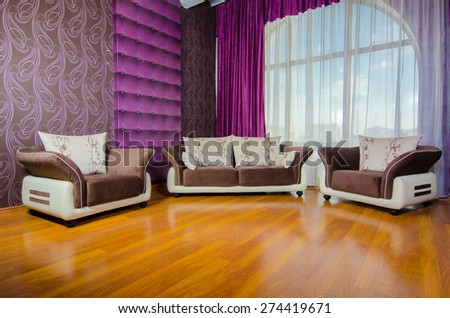 Modern living-room interior with couch near large window - stock photo