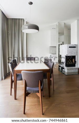 Modern living room interior with grey chairs and white  fire place
