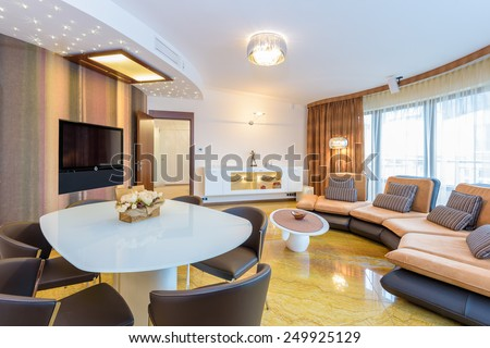Modern living room interior with marble floor in luxury apartment, Krakow city, Poland - stock photo