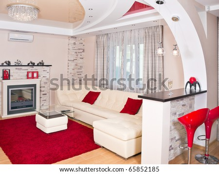Modern living room interior with red decoration - stock photo