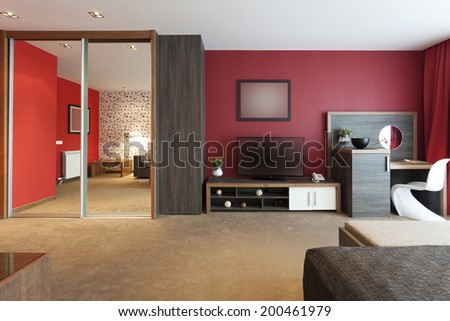 Modern living room interior with red walls - stock photo
