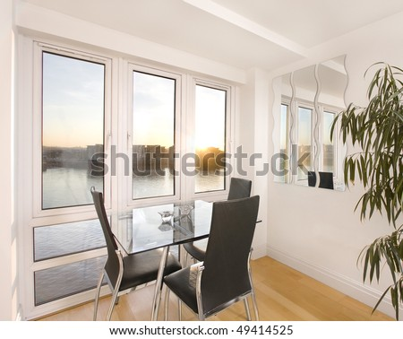 Modern living room overlooking the Thames river, London - stock photo