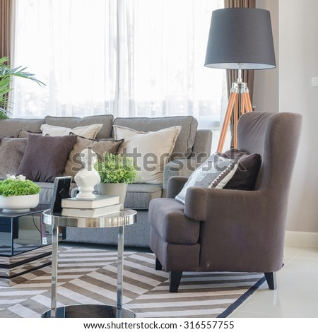 modern living room with brown modern sofa on carpet - stock photo