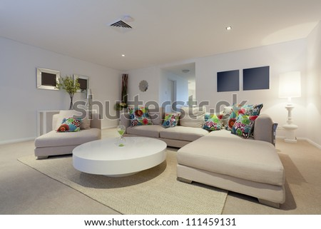 Modern living room with couch and round table in new Australian apartment - stock photo