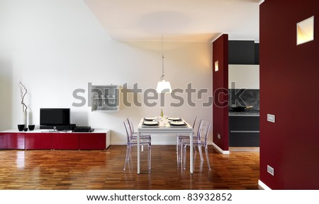 modern living room with dining table with wood floor - stock photo