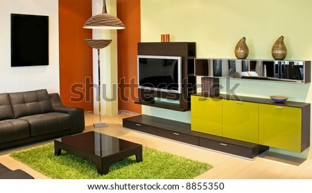 Modern living room with green and terracotta colors - stock photo