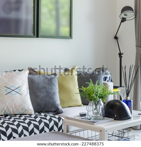 modern living room with row of pillows on sofa - stock photo