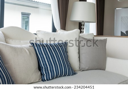 modern living room with row of pillows on sofa at home
