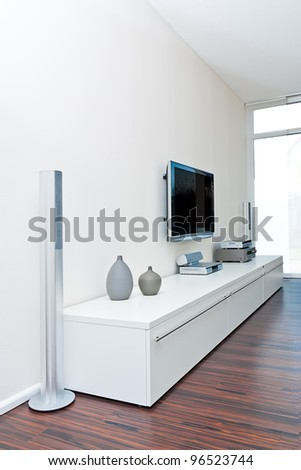 Modern living room with tv equipment - stock photo