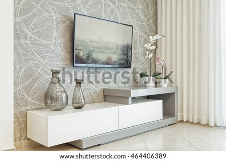 Modern living room with TV on wall
