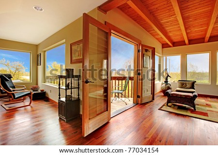 Modern living room with wood ceiling and floor. Custom build unique home in Seattle. Spring time. - stock photo