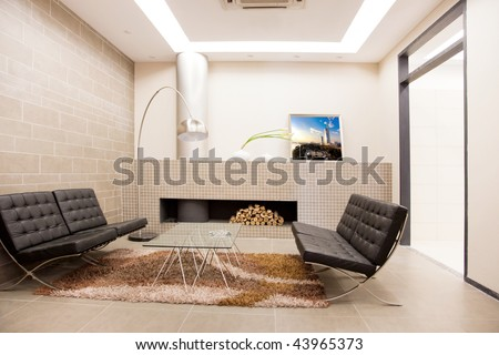 Modern livingroom with chairs and table - stock photo