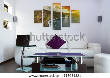 Modern lliving room interior with Cliffs of Moher canvas on the wall - it is my photo available in shutterstock gallery - stock photo