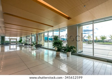 Modern lobby, hallway, plaza of the five stars luxury hotel, shopping mall, business center in Vancouver, Canada. Interior design.