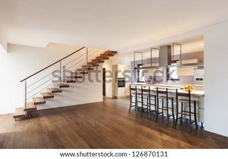 modern loft, view of the kitchen and stairs - stock photo