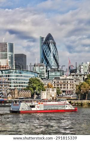 Modern London cityscape with boat, LONDON, UK - stock photo