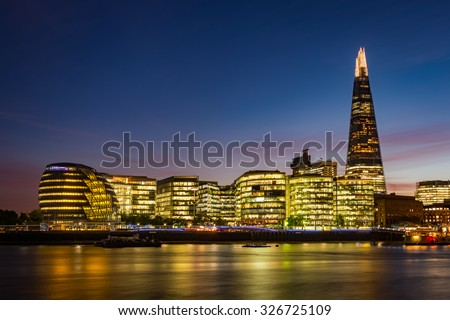 Modern London panorama after sunset - south bank of river Thames including the City Hall and The Shard - stock photo