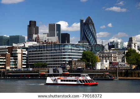 Modern London with city cruise, England - stock photo