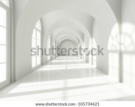 Modern long corridor with big windows - stock photo