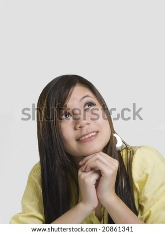 Modern looking Asian woman looking up - stock photo