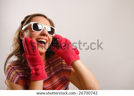 Modern looking young woman acting surprised - stock photo