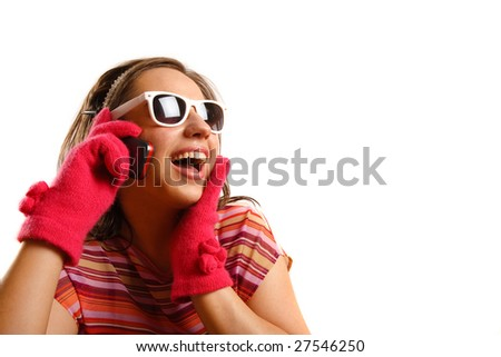 Modern looking young woman wearing sun glasses, talking on the phone - stock photo