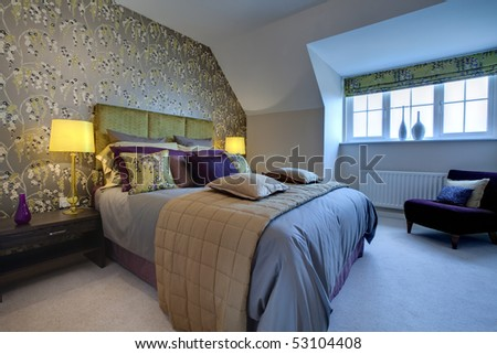 Modern luxurious bedroom dressed with opulent fabrics - stock photo
