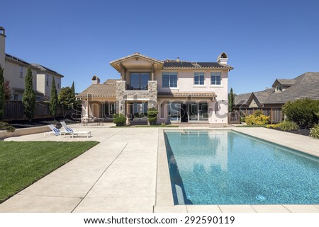 Modern luxurious house with endless pool. - stock photo