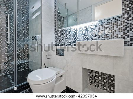 modern luxury bathroom with floor to ceiling mosaic tiles - stock photo