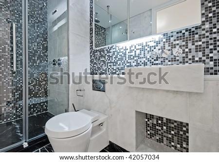 modern luxury bathroom with floor to ceiling mosaic tiles - stock photo
