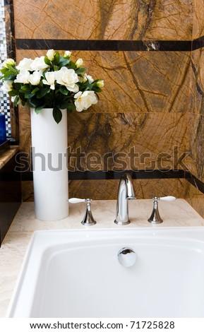 Modern luxury bathroom with flower. - stock photo