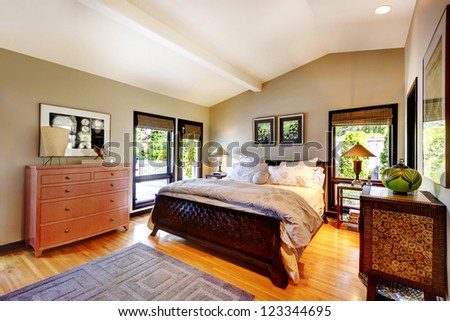 Modern luxury bedroom with bed, dresser and nightstand. - stock photo