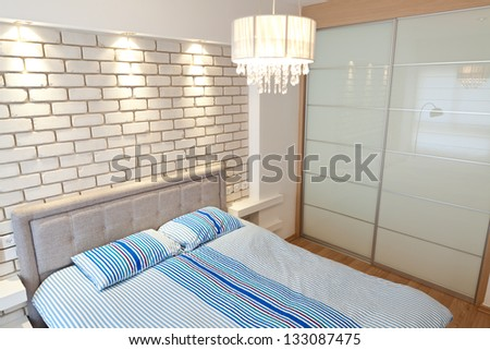 Modern luxury bedroom with decorative wall /  Hotel Room - stock photo