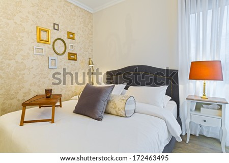Modern luxury bedroom with wallpaper /  Luxury Hotel Room - stock photo