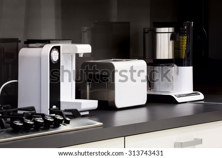 Modern luxury black and white kitchen in high tech style - stock photo