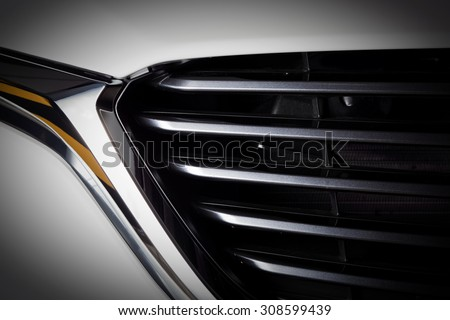 Modern luxury car close-up of grille. Background, concept of expensive, sports auto detailing - stock photo