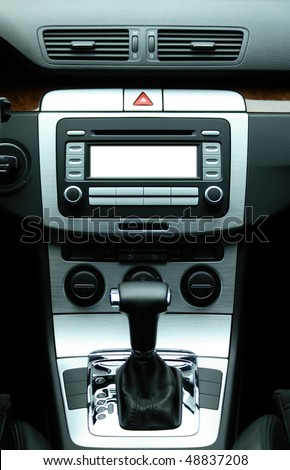 Modern luxury car interior with white space for text on center audio system - stock photo