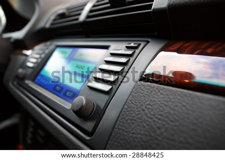 Modern luxury cars dashboard, with multifunctional display. Shallow DOF. - stock photo