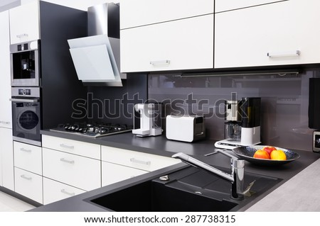 Modern luxury hi-tek black and white kitchen, clean interior design - stock photo